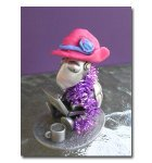 Shelly the SBI! tortoise wears her red hat and purple scarf outside