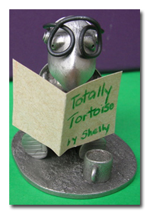 Shelly the Solo Build It! tortoise reads the book Totally Tortoise by Shelly